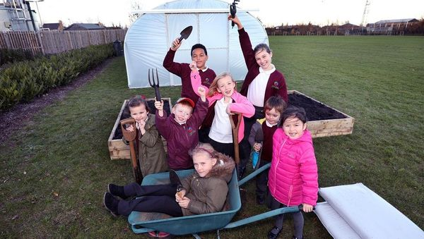 Ermine Street pupils celebrate as Morris Homes support new allotments